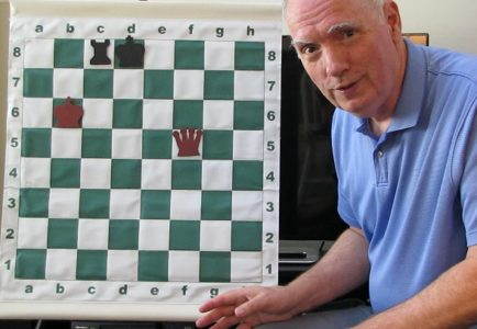 Chess teacher Jonathan Whitcomb demonstrates an endgame